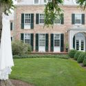 Wedding dress hanging on the tree outside of Drumore Estate
