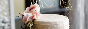 Wedding cake with gold lettering cake topper