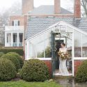 Bride in greenhouse during rainy day at Drumore Estate