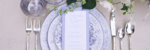 Lavender and silver wedding reception place setting