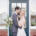 Bride and groom outside of greenhouse