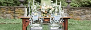 Garden Inspired tablescape with ghost cahirs