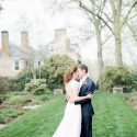Bride and groom embracing on lawn of Drumore Estate