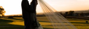 Bride's veil showcased with fields of Lancaster in the back