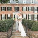 Bride and groom in front of Drumore Estate mansion