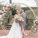 Circle arch in formal garden with pink and white flowers