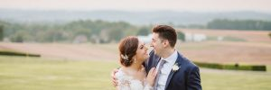 Bride and groom in countryside during sunset
